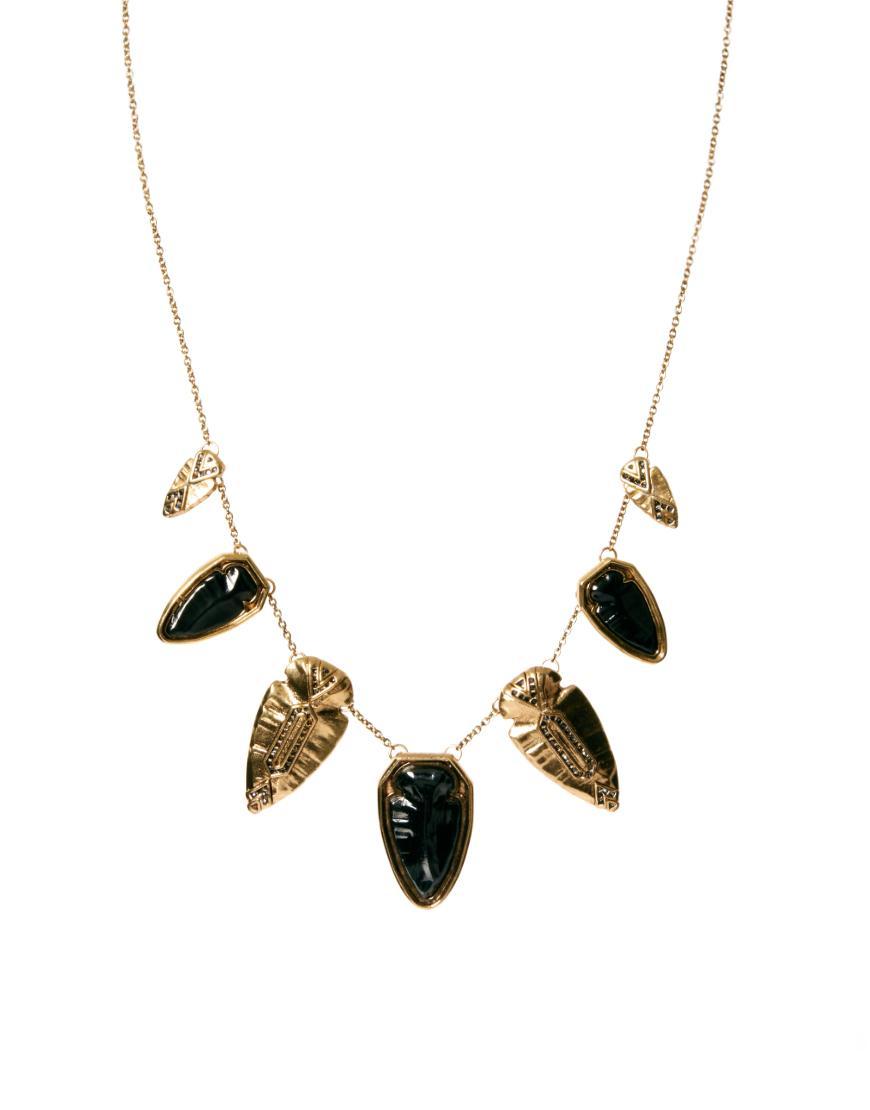 Foto Collar con cristales en forma de punta de flecha en metal dorado y ...