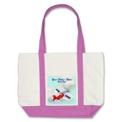 Foto La bolsa de asas del avión de la cigüeña del bebé